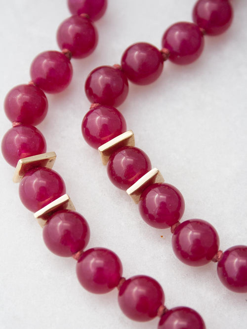 Odyssey Meditation Mala, in 10mm hand-knotted crimson red aventurine, with brass Guru and Path of Life. Bead view