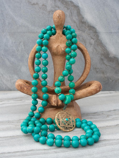 Infinity Mala in distinctive 10mm green turquoise, with brass Mandala: full view