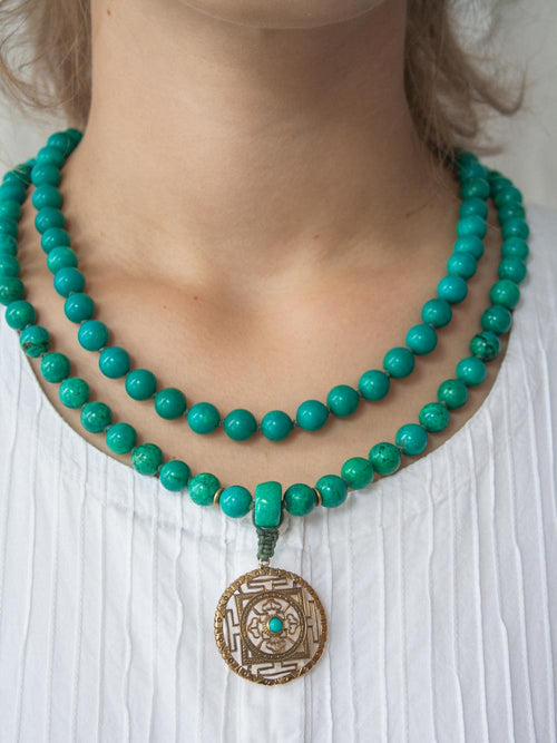 Infinity Mala in distinctive 10mm green turquoise, with brass Mandala: necklace view