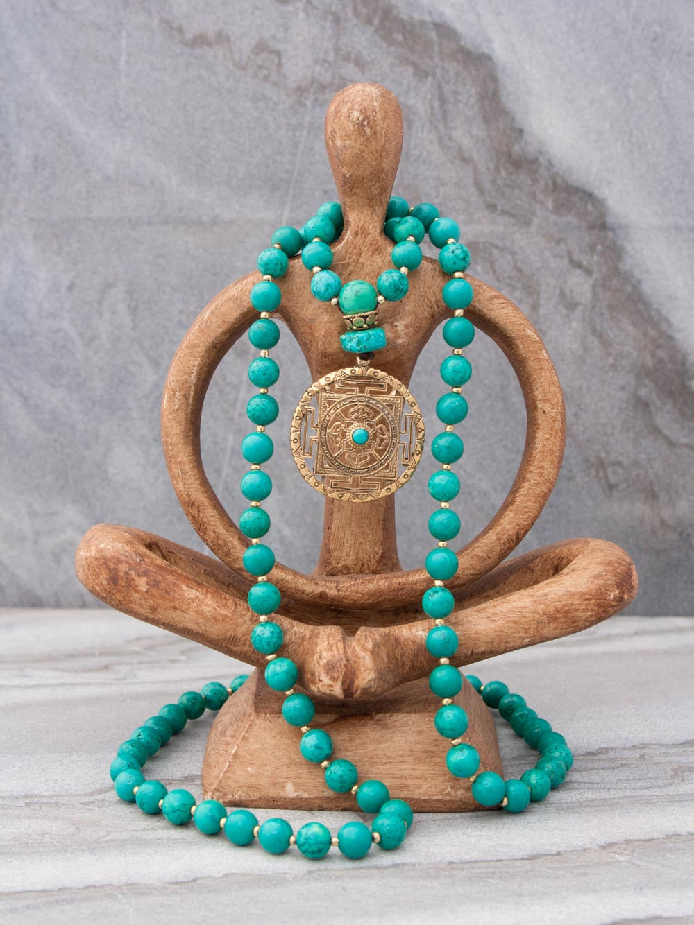 Infinity Celebration Mala in distinctive 8mm turquoise, with brass Mandala: full view