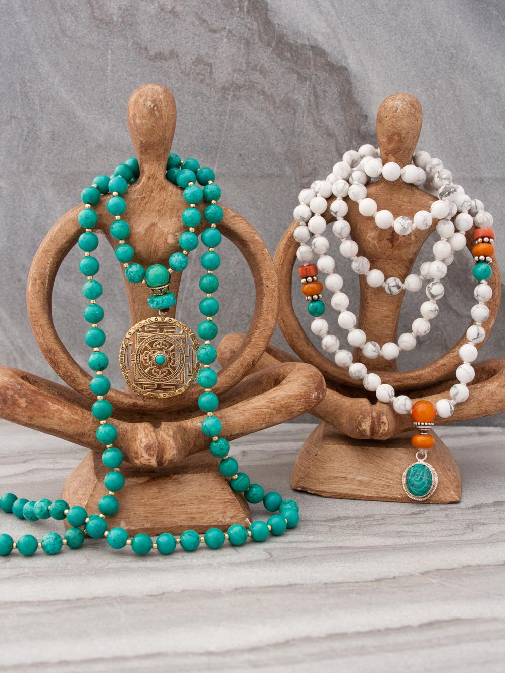 Infinity Celebration Mala in distinctive turquoise, shown with Victory Ganesh Mala in alabaster howlite with turquoise accents