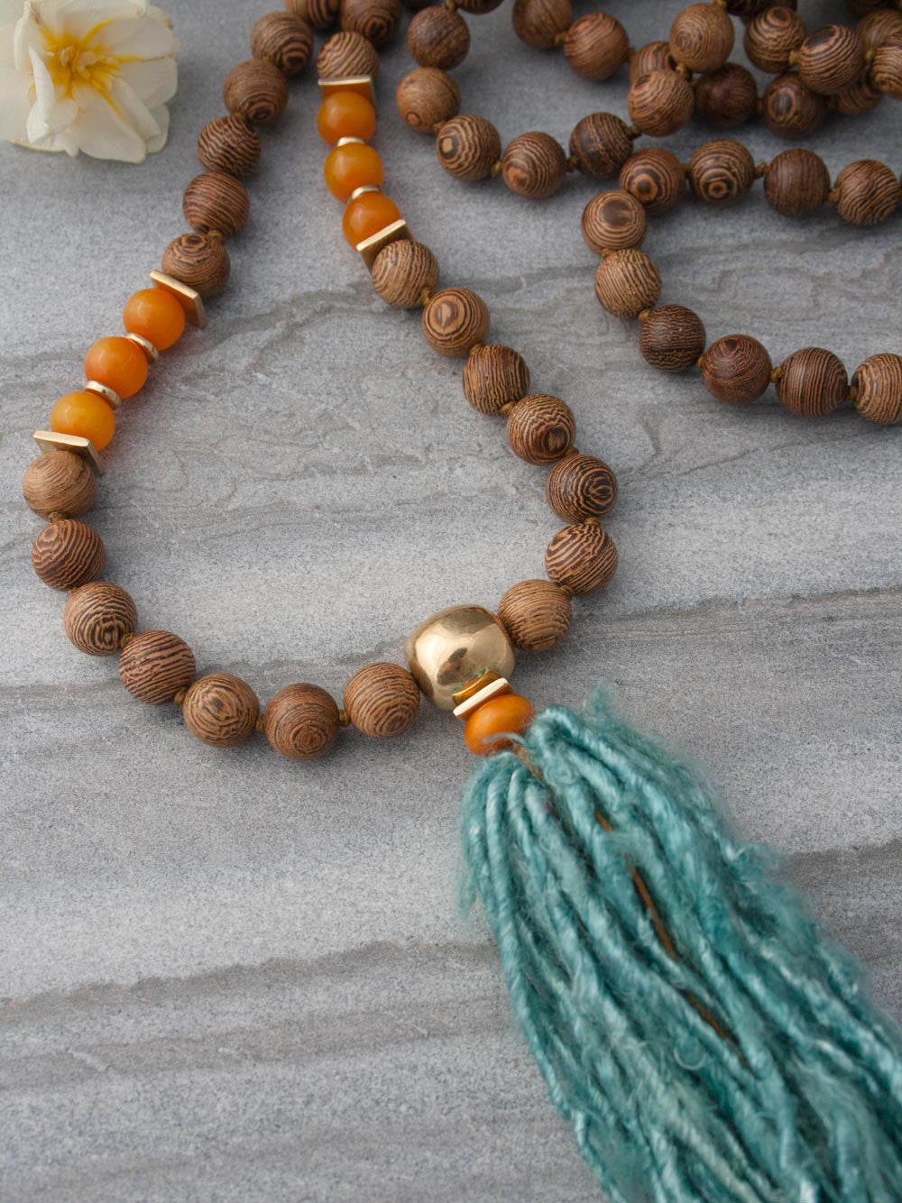 Eternal Existence Mala is made of 10mm wengewood beads, & has amber accents & a sari silk tassel: Guru bead & accents view
