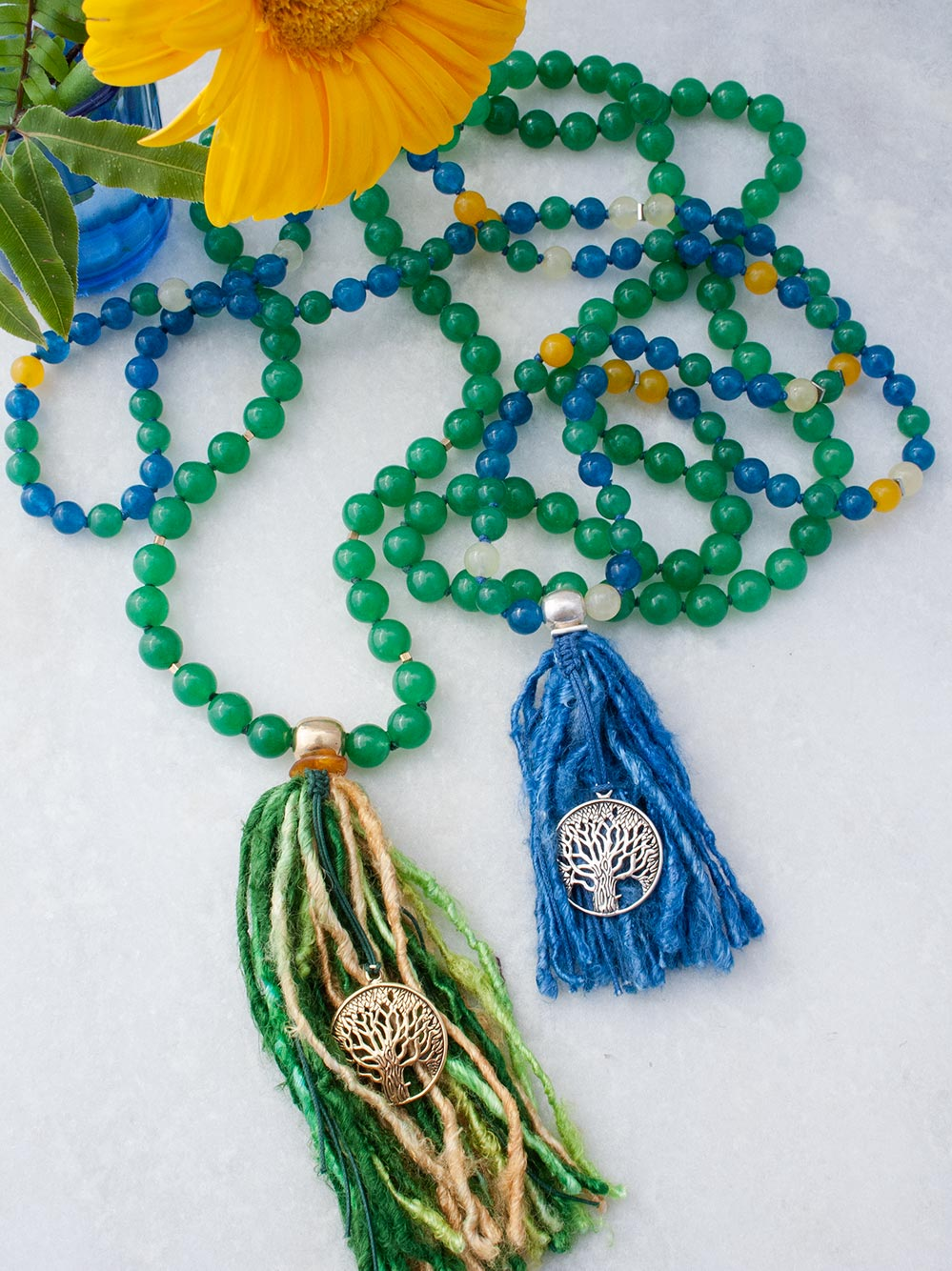 Surprise Mala and Serendipity Mala in  multi-colour Aventurine with tree of life and sari silk tassel. Full view of both.