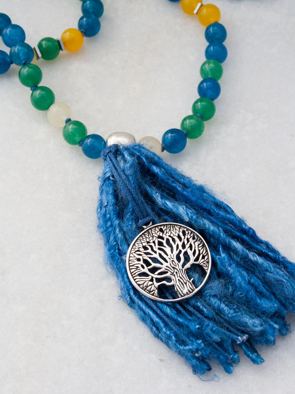 Serendipity Mala in peacock blue/sylvan green/citrine and aurora gloria yellow aventurine, with 925 silver tree of life. Tree of life/tassel view.