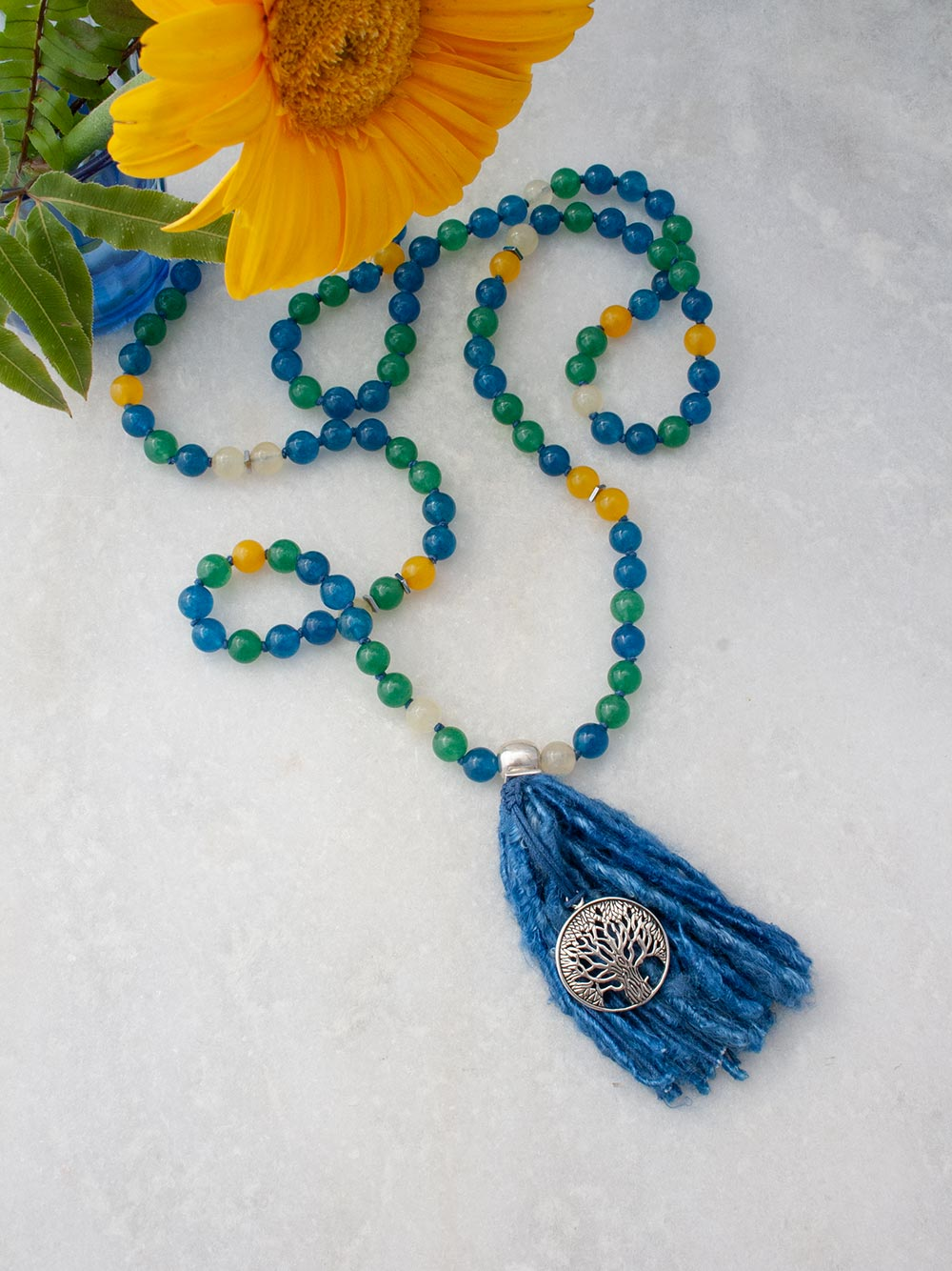 Serendipity Mala in peacock blue/sylvan green/citrine and aurora gloria yellow aventurine, with 925 silver tree of life. Full view.