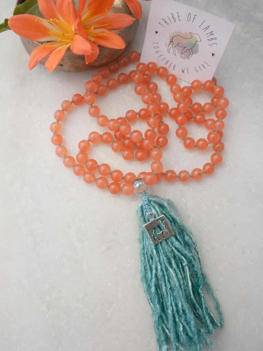 Our sweet and spunky Tribe of Lambs Mala in 10mm Tuscan peach aventurine with silver Tribe of Lambs pendant and sari silk tassel: full view.