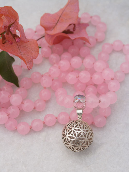 Blossoming Flower Mala in rose pink aventurine has crystal Guru and 925 silver flower of life. Full view.