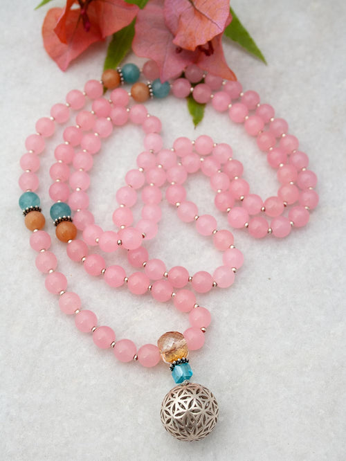 Budding Flower Mala in 8mm rose pink aventurine has complementary accents and crystal guru and 925 silver flower of life. Full view.