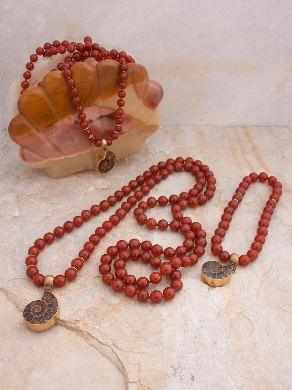 To Infinity... a 108 bead Mala in spectacular sienna onyx, 10mm, with brass Guru bead and ammonite nautilus pendant: view of 108 bead, 81 bead, and 27 bead Malas.