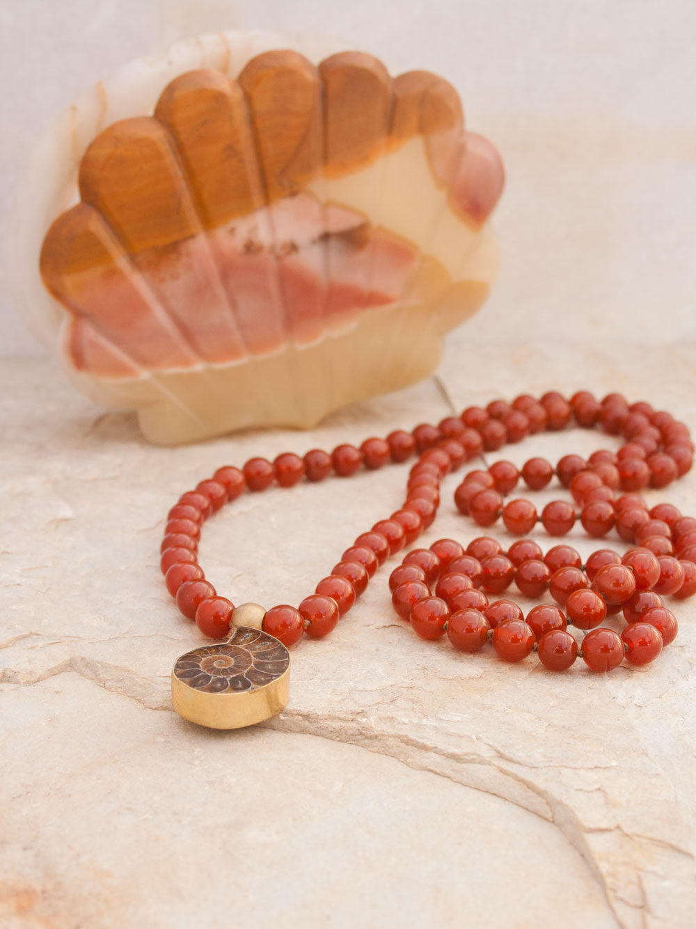 To Infinity... a 108 bead Mala in spectacular sienna onyx, 10mm, with brass Guru bead and ammonite nautilus pendant: full view.