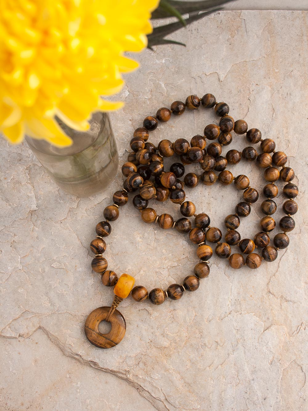 The Jupiter Mala, in 12mm tiger's eye with powerful Guru setting in amber and tiger's eye.  Full view.