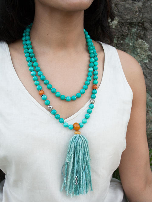 Spirit Mala, in 10mm turquoise with amber accents and sari silk tassel, also has a silver Vajra ~ representing resolute spirit: necklace view.