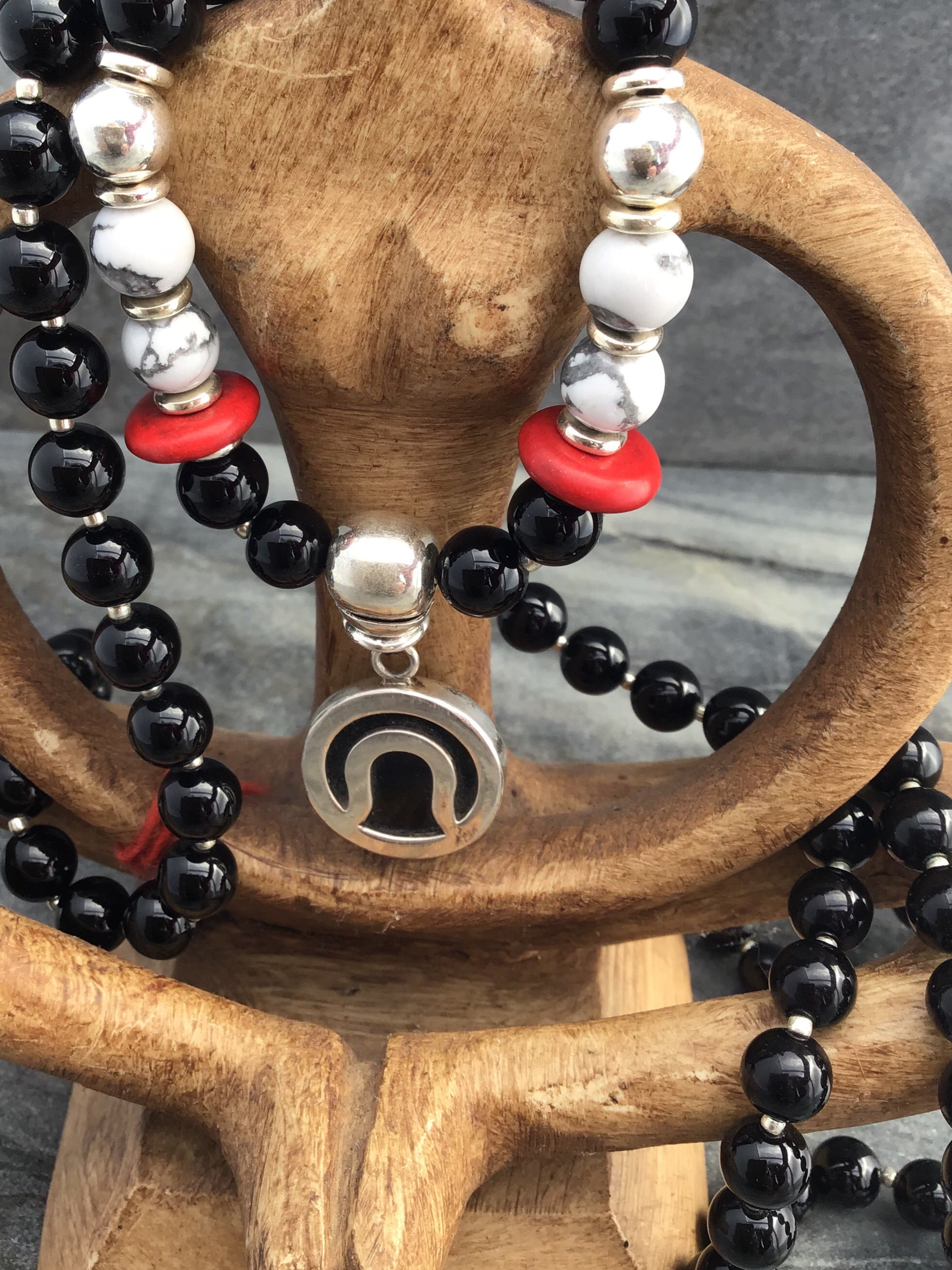 Immortal Am I Celebration Mala in obsidian black onyx with howlite and 925 silver. Guru setting view.