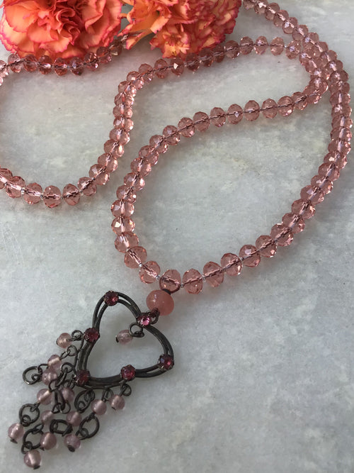 Rose Coloured Glasses Mala in vintage rose crystalline and dancing heart Guru setting. Full view.