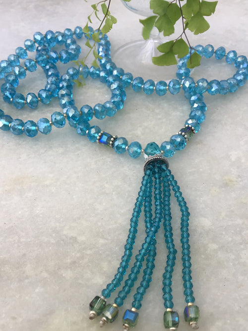 Lallapalooza Mala in Bahama blue crystalline glass with exquisitely beaded crystal tassel. Full view.