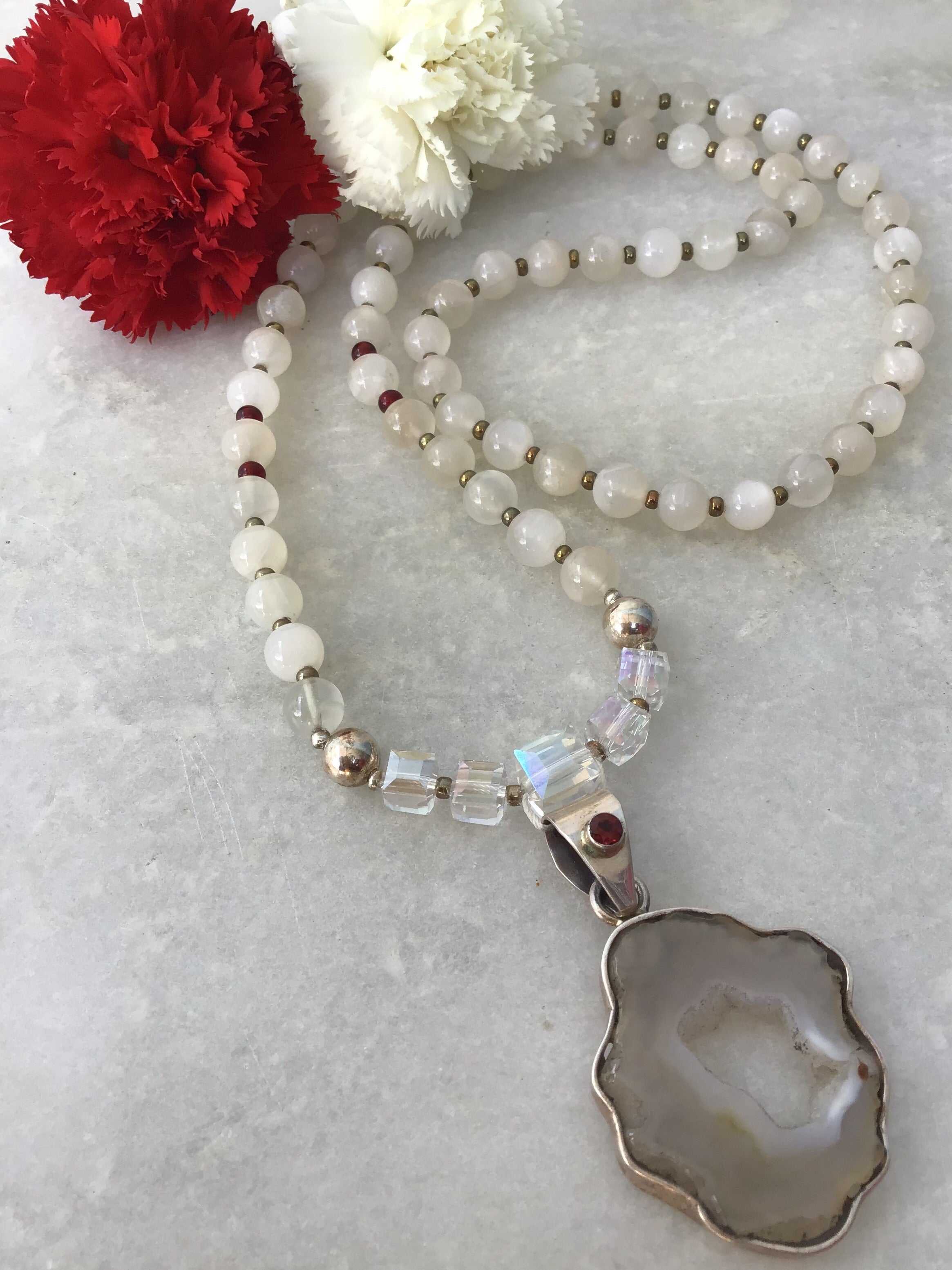 Moon Goddess Mala in celestial moonstone with garnet and 925 silver accents and stellar drusy agate Guru setting. Full view.