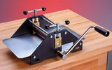 Clamps can be used to lock this Fome #3620 Etching Press to the table