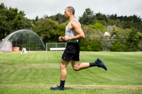 Man running in Lily trotters compression socks