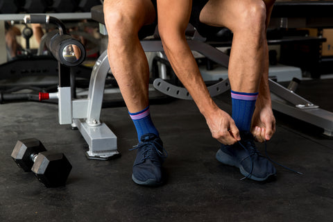 Man tying shoelaces wearing Lily Trotters compression socks