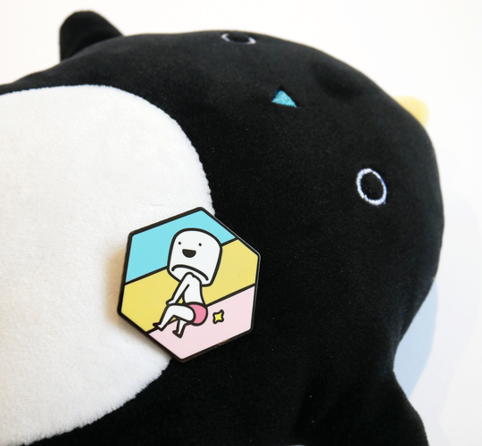 Booty boy marshmallow enamel pin posed