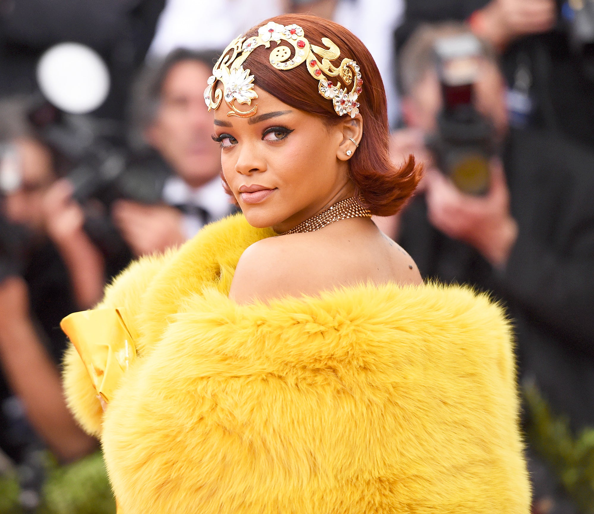 Rihanna_met_gala_yellow_fur_thepompommery