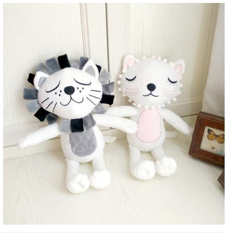 "alt=""cat and lion plush toys"""