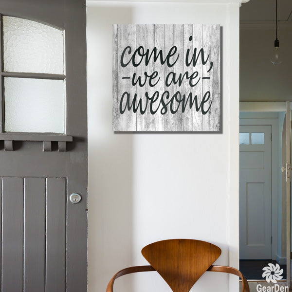 """Come In, We Are Awesome"" black canvas wall art"
