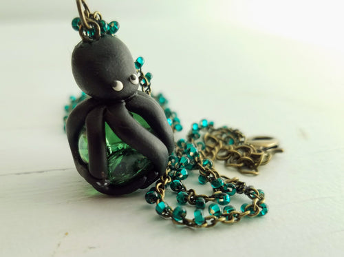 Cracked marble engulfed by polymer clay octopus on mermaid blue glass beaded chain necklace - The Treasures of Time: reclaimed and handcrafted goods
