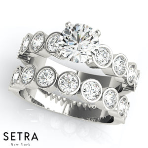 ENGAGEMENT RINGS SINGLE ROW BEZEL SET
