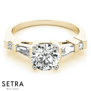14K GOLD ROUND & TAPER BAGUETTE CUT DIAMOND ENGAGEMENT RING