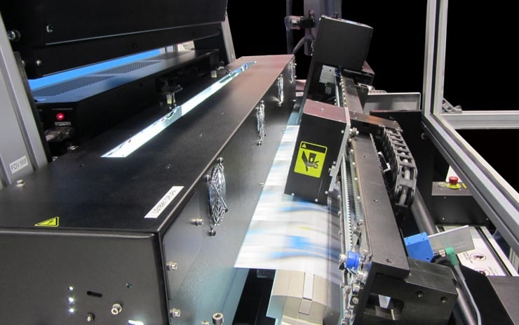 An inline spectrophotometer measuring color on a printer