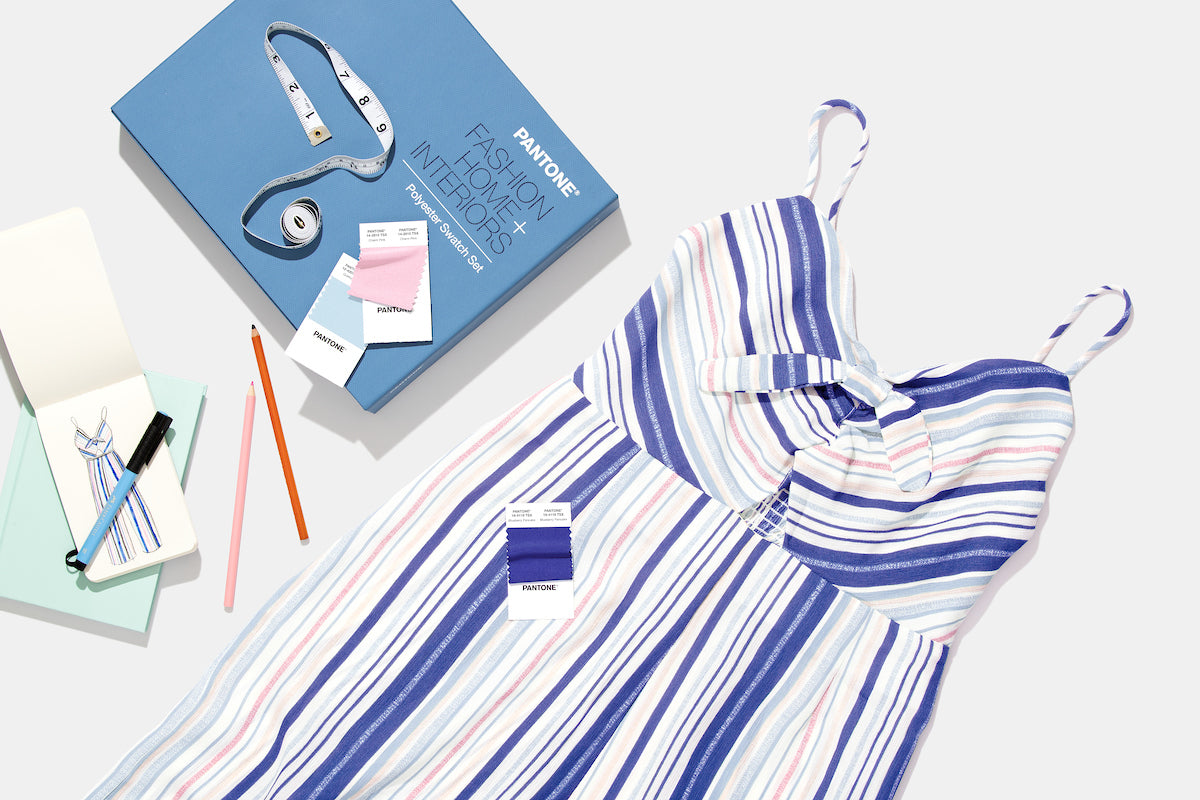 Pantone Fashion Home and Interiors Polyester Swatch Set and Dress with the design of the dress drawn on paper