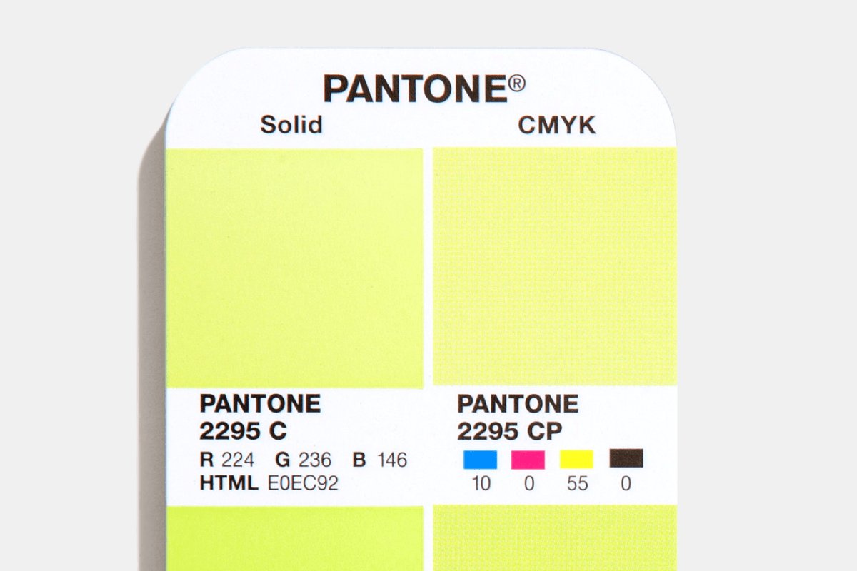 Close up of the Pantone Color Bridge Coated Guide showing PMS, RGB, HTML HEX, and CMYK Numbers.