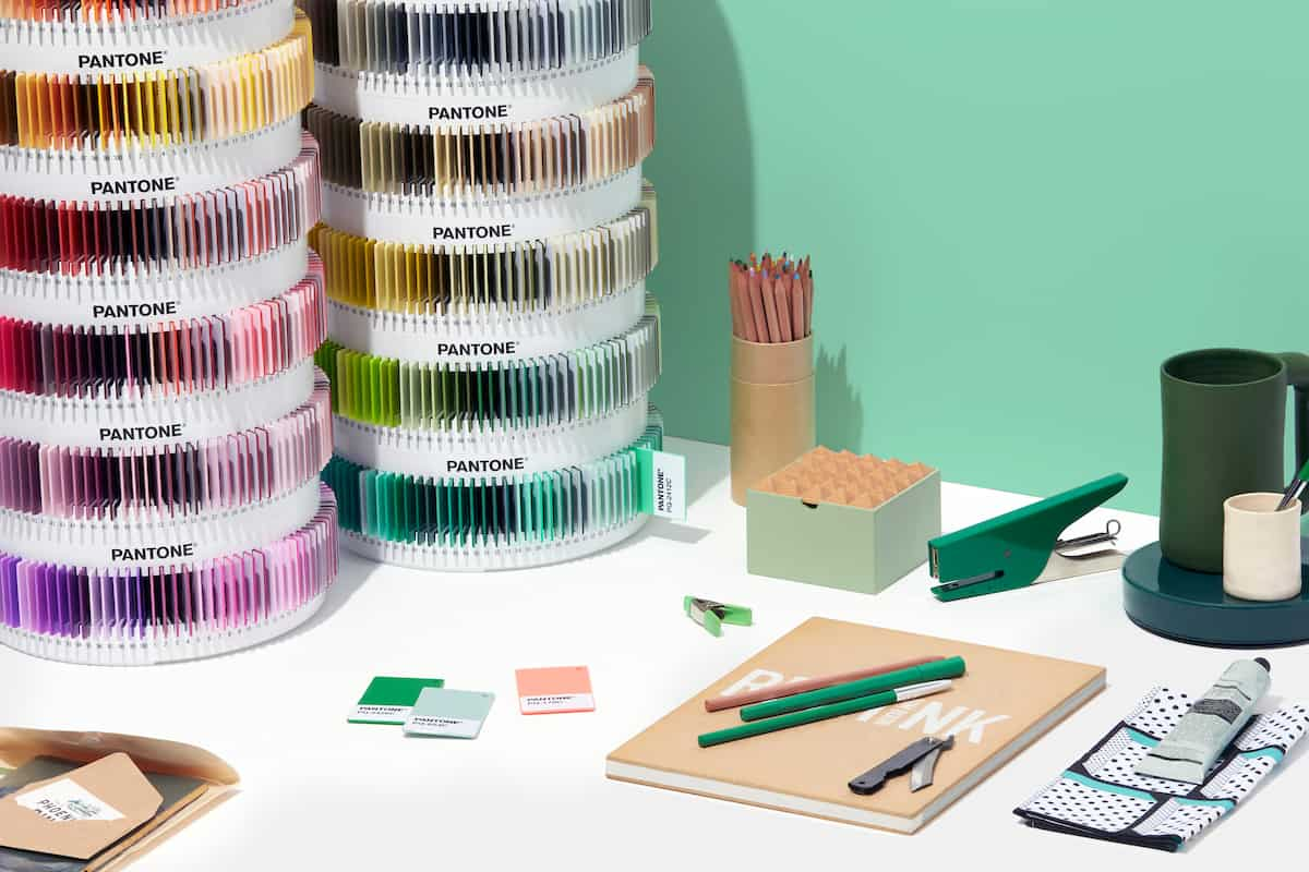 Pantone Plus Plastics Collection in container towers on a desk