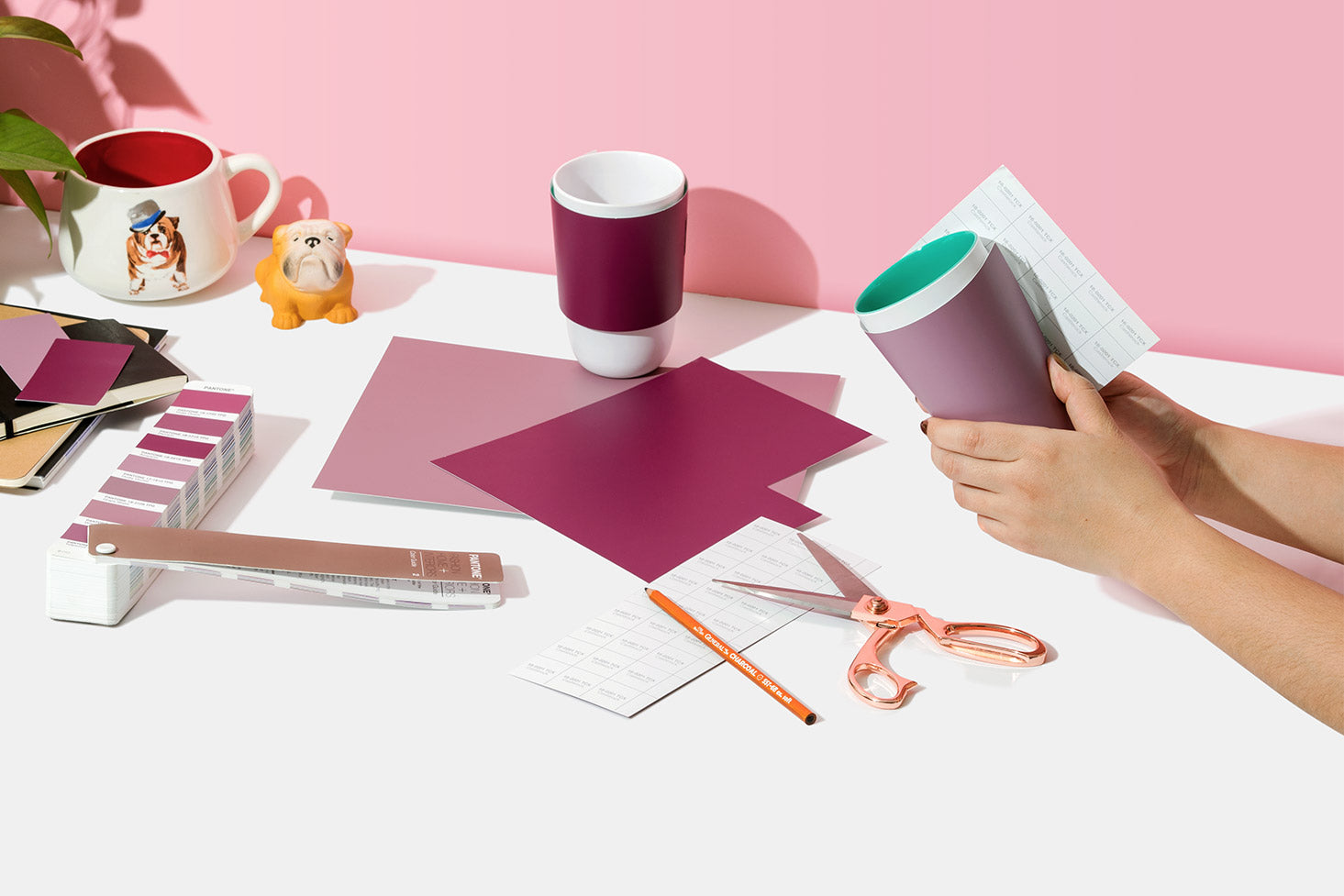 Textile Paper-Green TPG Sheets being wrapped around a cup with scissors on table