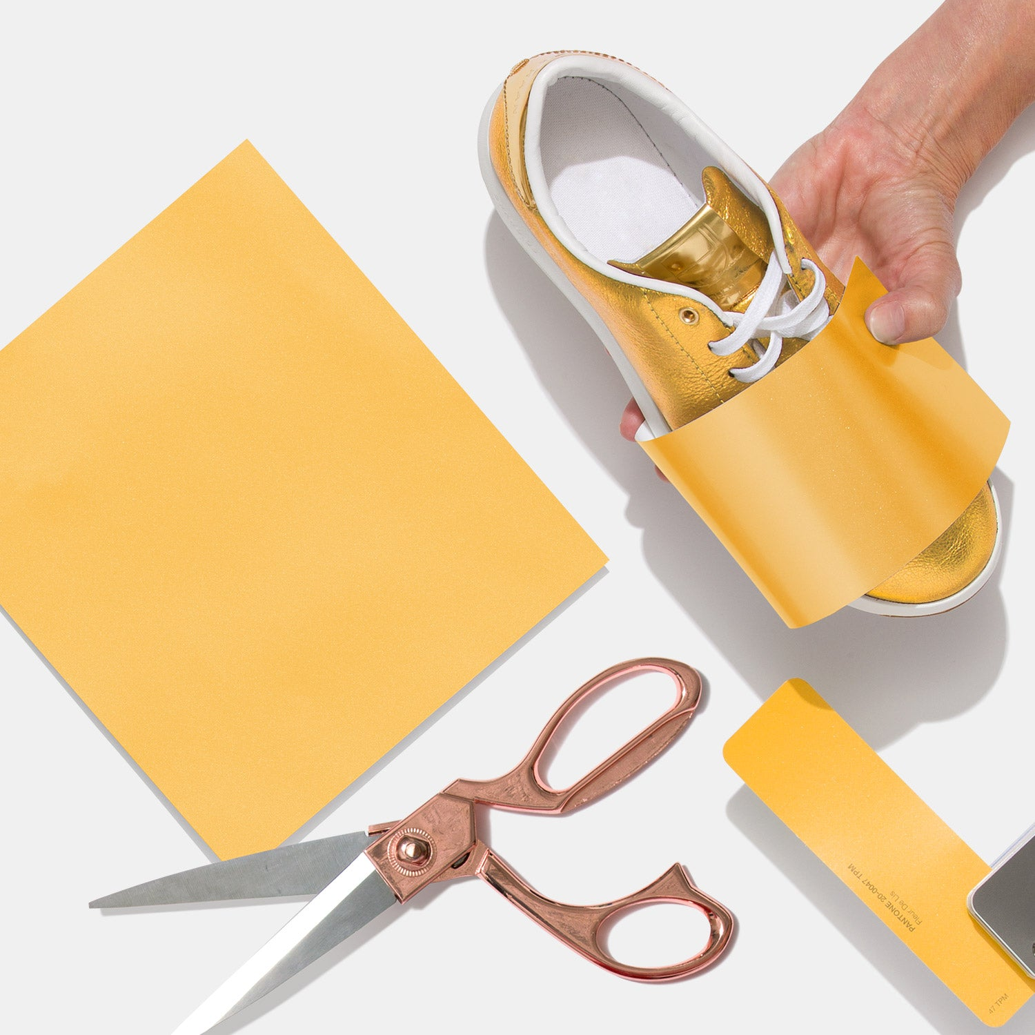 Yellow Textile Paper-Metallics TPM Sheet wrapped around sneaker with scissors