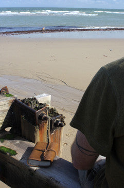 Jason Lineham at the beach with his Earthworks Journal