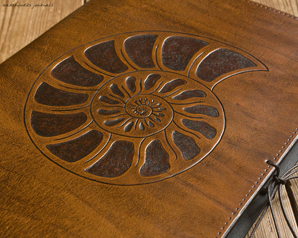 A4 brown leather journal - spiral ammonite design detail - earthworks journals A4C012