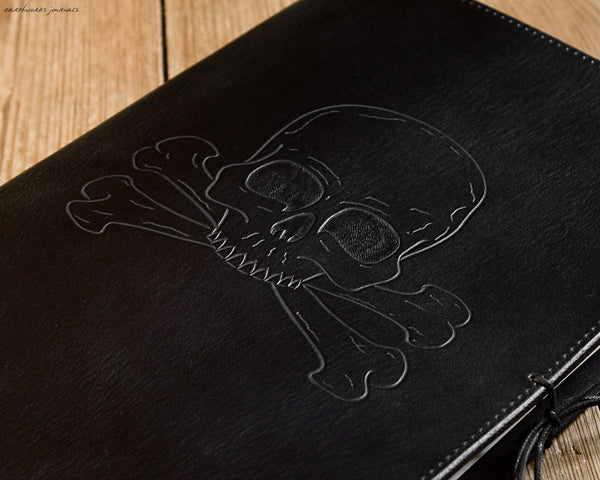 A4 black leather journal - ship's log - skull and crossbones design detail - earthworks journals A4C015
