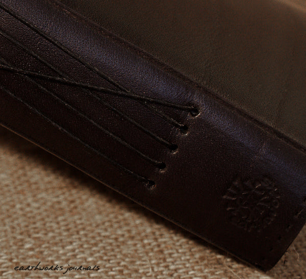 A4 black leather journal - spine detail - earthworks journals