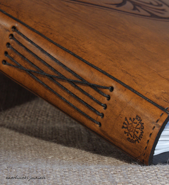 A4 brown leather journal - spine detail - earthworks journals