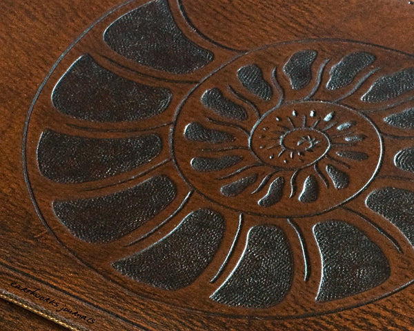 A5 brown leather journal - ammonite seashell design detail - earthworks journals - A5C002