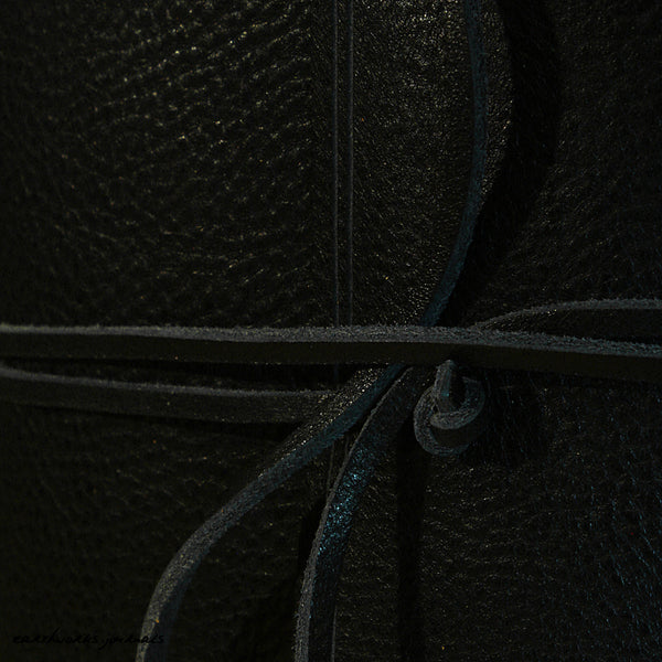 A6 rugged black leather journal - wraparound detail - earthworks journals - A6W008