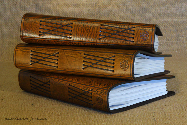 A5 brown leather journals spines - earthworks journals