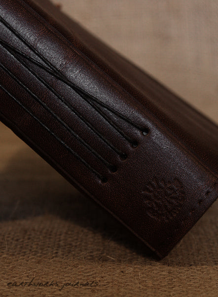 a6 black leather journal - spine - earthworks journals