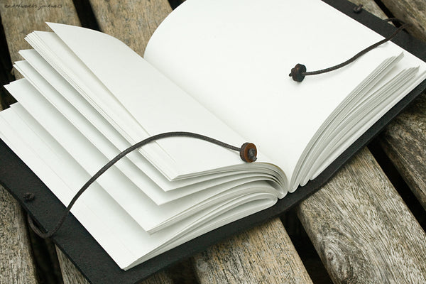 A6 hand bound leather journal - open - earthworks journals
