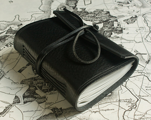 A6 rugged black leather journal 4 - wraparound - earthworks journals - A6W008