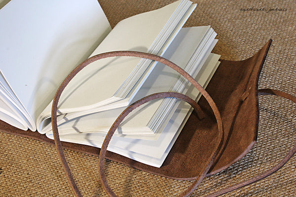 A6 rugged dark brown leather journal - wraparound open - earthworks journals - A6W002