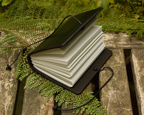a7 hand bound black leather journal - open - earthworks journals