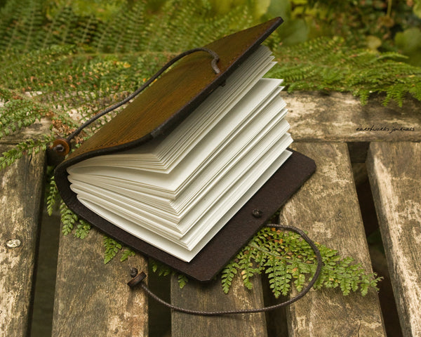 a7 hand bound leather journal - open - earthworks journals